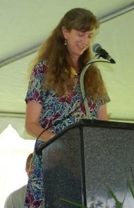 Elizabeth speaking at a high school graduation