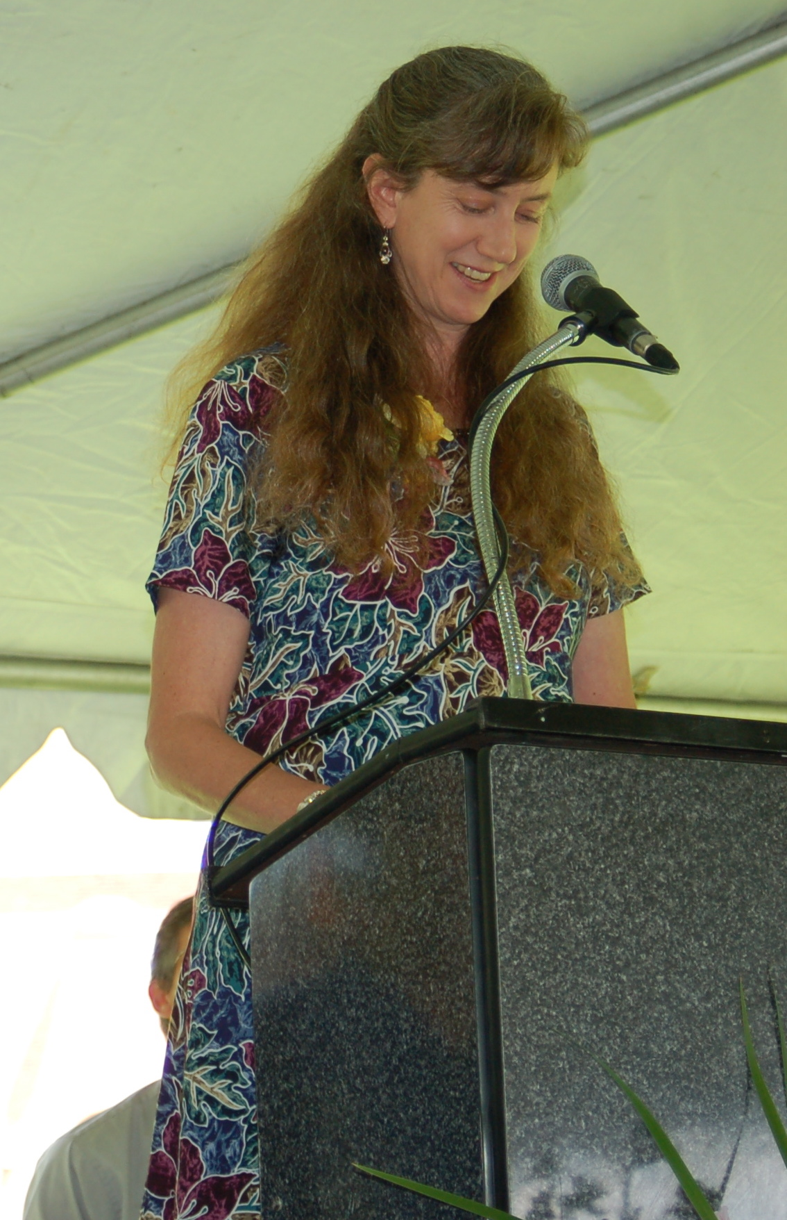 Elizabeth speaking at a high school graduation